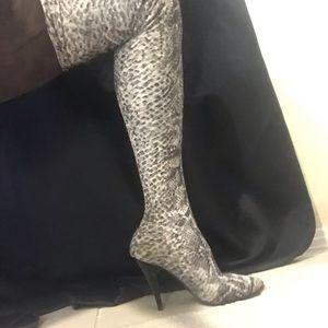 Thigh high Lycra boots